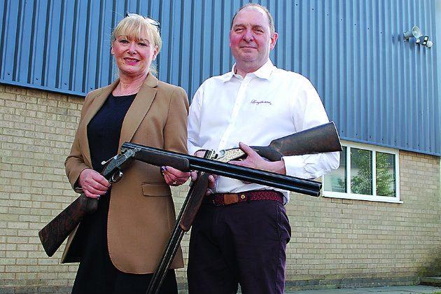 man and woman gun manufacturers
