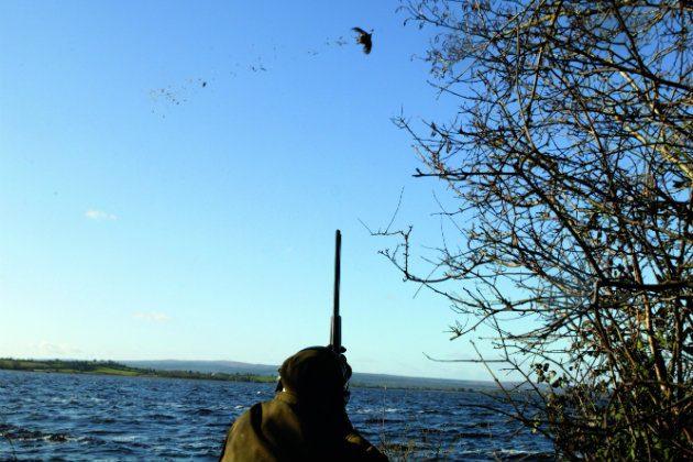 Man shooting by lake