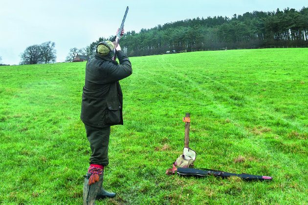 Man with shot load in field
