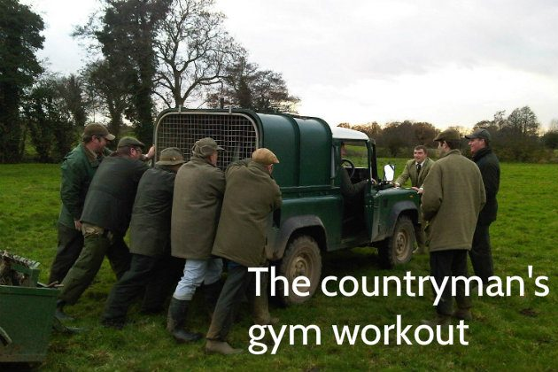 Land Rover being pushed by gamekeepers