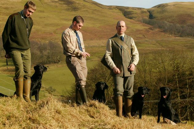 (Far right) David Lissett with his gundogs