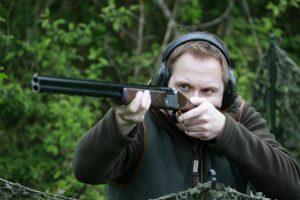 Man taking aim with a 28-bore shotgun