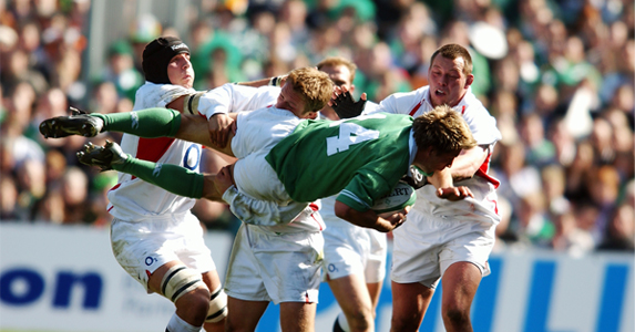 Jonny Wilkinson upends Justin Bishop of Ireland during the final game of the 2003 Six Nations