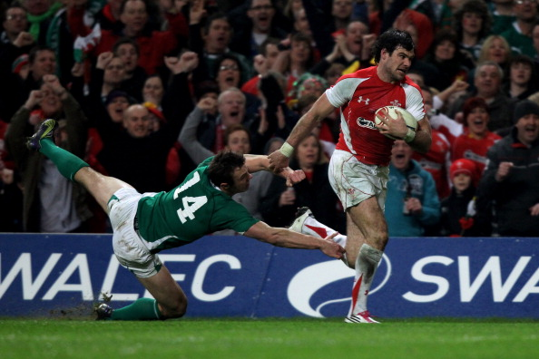 A try or not a try: Mike Phillips hands off Tommy Bowe to score for Wales
