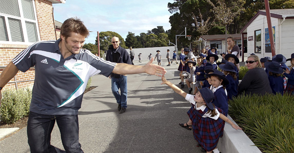 McCaw keeping busy with some community work while out injured