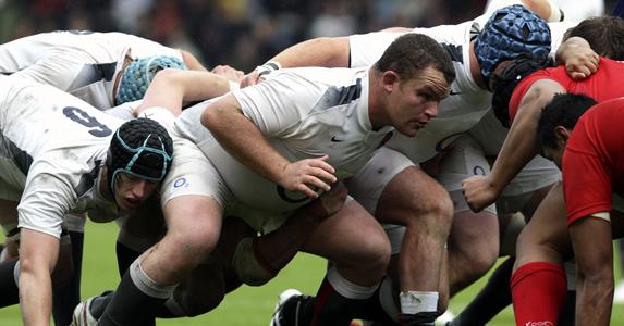 England Saxons prop Matt Stevens tackles Tonga Lea'aetoa at Kingsholm