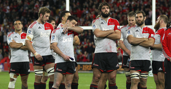 A very disappointed Crusaders team looking on while the REds celebrate their much deserved victory