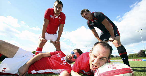 Sam Warburton and George North stand over GLC members Rhys and Eggsy