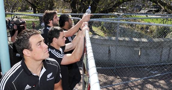 Richard Kahui inspects the devastation caused by the February 22 earthquake as he and other All Blacks tour the affected areas