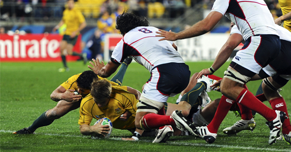 Drew Mitchell scores his team's fifth try against USA, in his first start at the World Cup after recovering from a dislocated break to the ankle