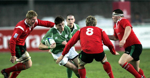 Bradley Davies(L), Lewis Evans(C) and Kenneth Owens(R), try and stop Ireland's winger Shane Monahan in U19 clash