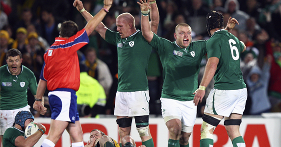 Paul O'Connell, Tom Court and Stephen Ferris of Ireland celebrate victory over Australia during the RWC Pool C match
