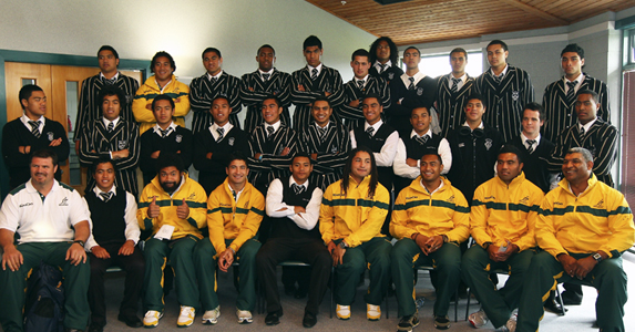 Sekope Kepu (front row 3rdR) of the Wallabies poses with team mates and students from Wesley College