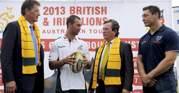 Victorian Premier Ted Baillieu (L) talks with Australian rugby union star Quade Cooper (2/L), ARU Managing Director and CEO John O'Neill (2/R) and Welsh international player Gareth Delve (R) at the 2013 Lions Tour
