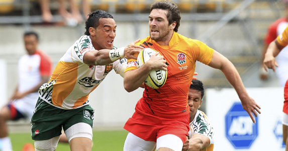Mat Turner is tackled by Jerome Vogel of the Cook Islands, Wellington.