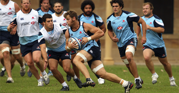 Pat McCutcheon runs with the ball during Waratahs training in Sydney