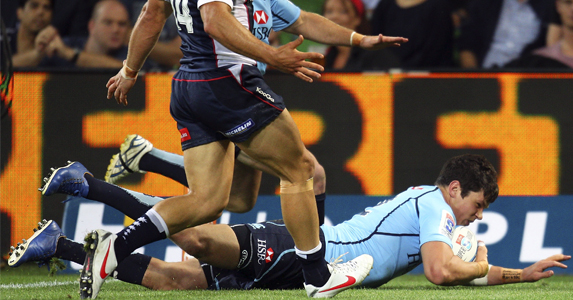 Tom Carter goes over the line for his second try against the Rebels