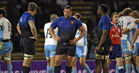 France's lock Pascal Pape (R), prop Vincent Debaty (C) look dejected after losing to Argentina