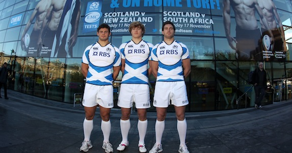 Flying the flag: Ross Ford, David Denton and Sean Lamont model the new Scotland change strip