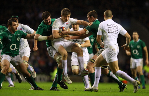 Carried away: Farrell in the 2012 match with Ireland