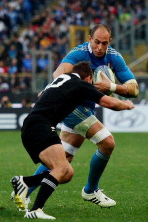 Bruiser: Sergio Parisse fends off the All Blacks