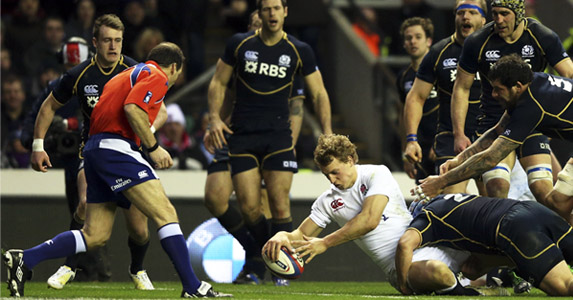 Blown away: Scotland are unable to stop Billy Twelvetrees scoring during England's 38-18 Calcutta Cup victory