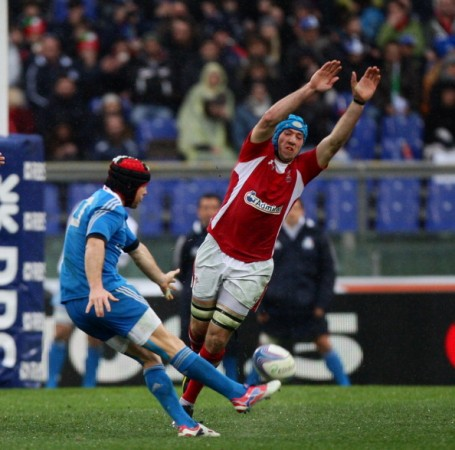 Committment: Justin Tipuric tries a charge down