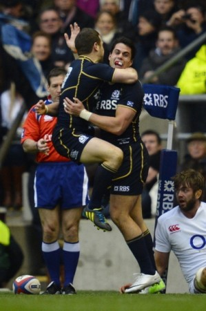 Sean Maitland celebrates his try with Greig Laidlaw (left)