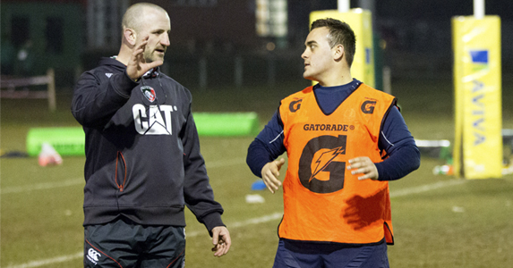 Chuter instructs Imran Edwards during Kettering's session with Leicester players including Marcos Ayerza, Matt Cornwell
