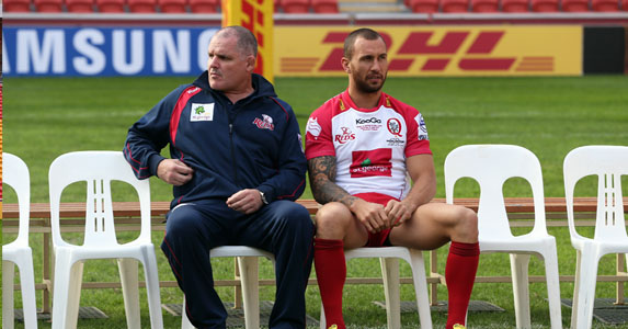 The calm before the storm: Ewen McKenzie and Quade Cooper take a chair before the rush of playing the Lions