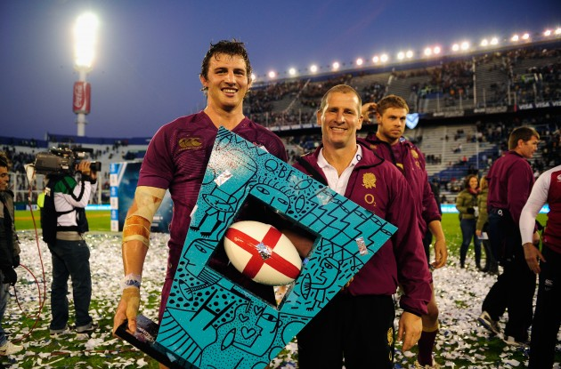 The World's worst trophy?: Lancaster and Wood celebrate an England victory