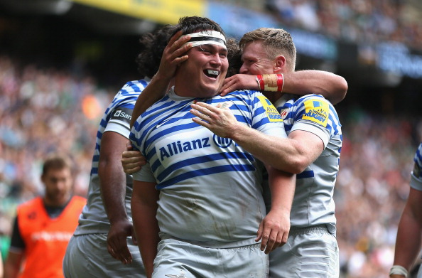 Star in stripes: Try-scorer Jamie George is congratulated by his team-mates at Twickenham last weekend