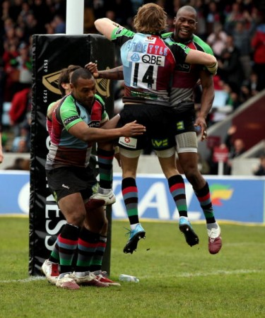Jumping for joy: Strettle in his Harlequins days, celebrating with Ugo Monye