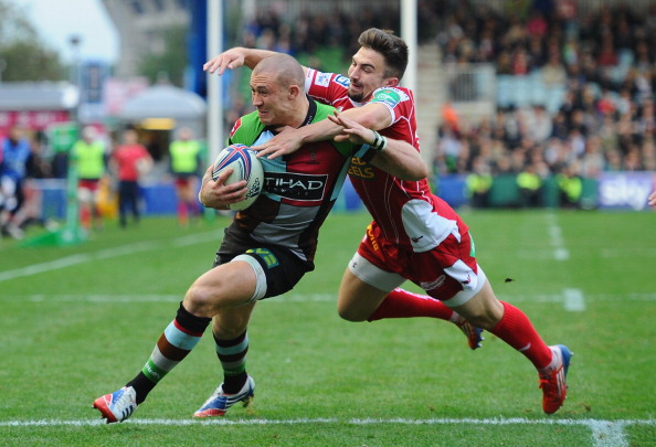 Hang on: Williams tries to pull down Quins full-back Mike Brown