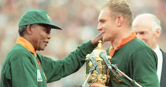 The iconic moment Nelson Mandela handed the Webb Ellis cup to Francois Pienaar, uniting South Africa in celebration