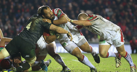 Lean and mean: John Afoa smashes his way onto the front foot in the crunch match with Leicester Tigers