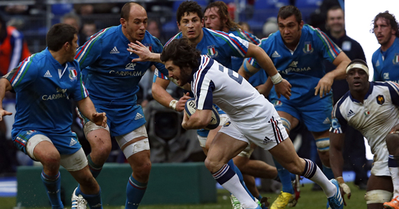 Blue wall: Maxime Machenaud tries to find his way past the Italian defence