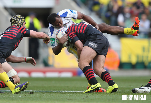 Blown away: Sitiveni Sivivatu is knocked onto his backside by Saracens' Schalk Brits