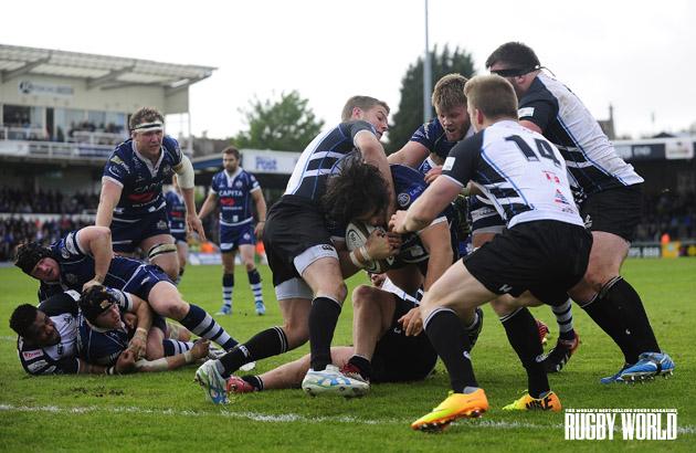 Memorial mash: Bristol's Gaston Cortes somehow gets through Titans' tackles to score