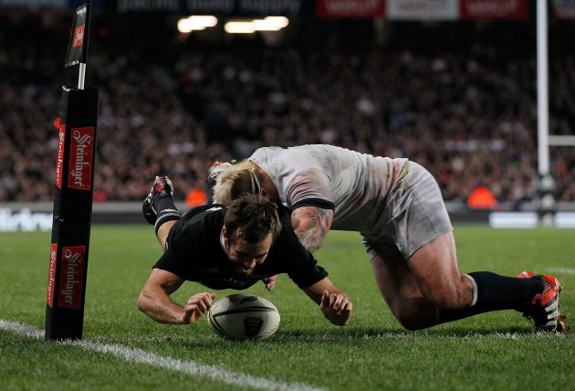 The deciding moment: Conrad Smith touches down to score the only try of the Test