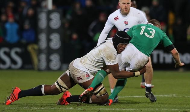 Rising star: Maro Itoje chops down Keith Earls at the Irish Independent Stadium