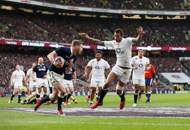 Long arms of the Lawes: England's lock bears down on Scotland fly-half Finn Russell