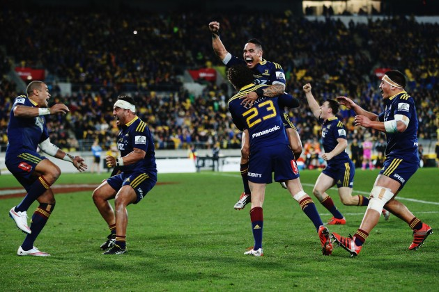 Magic moment: The Highlanders celebrate at the final whistle of the Super 15 decider