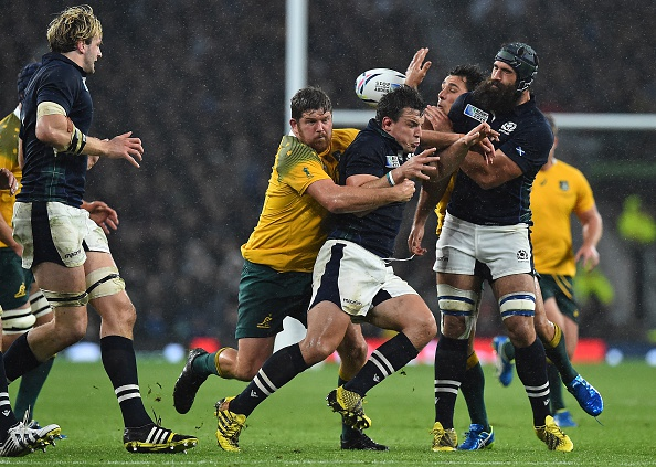 Pivotal moment: The ball ricochets from Australia's prop Greg Holmes, Scotland's flanker John Hardie, Australia's scrum half Nick Phipps and Scotland's back row forward Josh Strauss challenge for it, leading to a penalty awarded to Australia