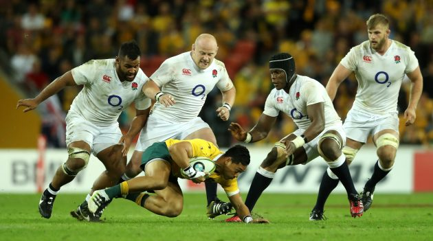 Crowded house: England's forwards swamp Australia centre Christian Lealiifano during England's 39-28 win in Brisbane