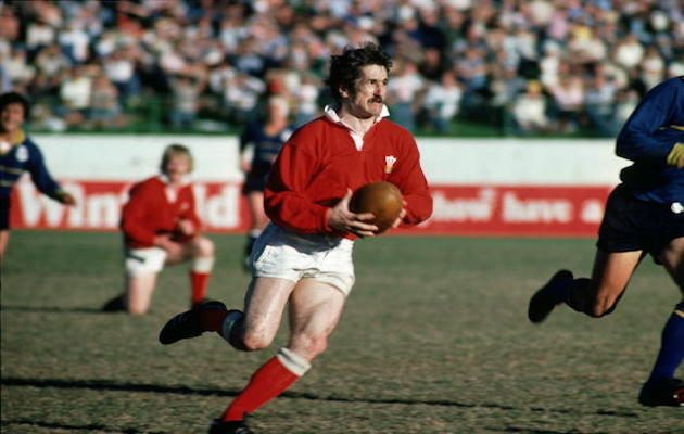 Gerald Davies of Wales runs with the ball during the Welsh tour to Australia.