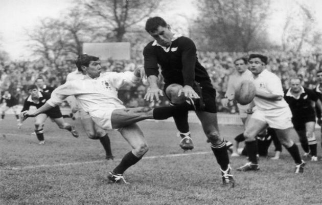 Colin Meads charges down a kick
