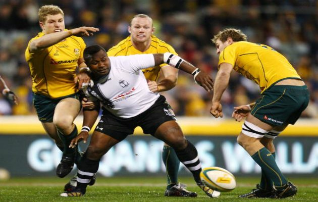 Rupeni Caucaunibuca fends off the Aussies