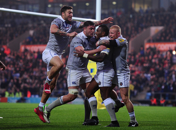 Dance of delight: Bath's players congratulate Rokoduguni on his late try.