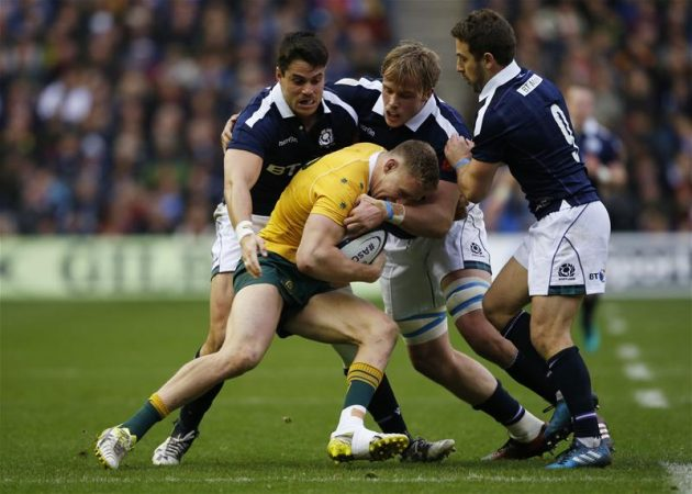 Grapple tackle: Jonny Gray gets to grips with Australia centre Reece Hodge Reuters/Russell Cheyne